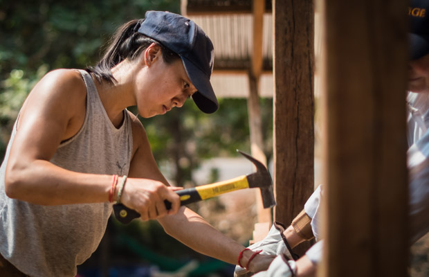 Anita volunteering to build a house with VBC