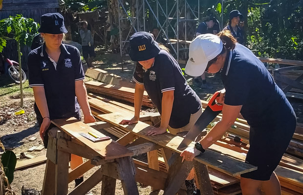 School students preparing to build a house with VBC