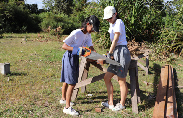 Students from St Peters and St Alfred's schools help build a hou