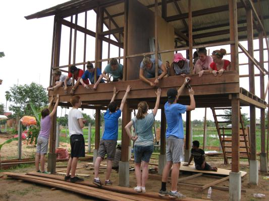 Volunteer Building Cambodia build a house